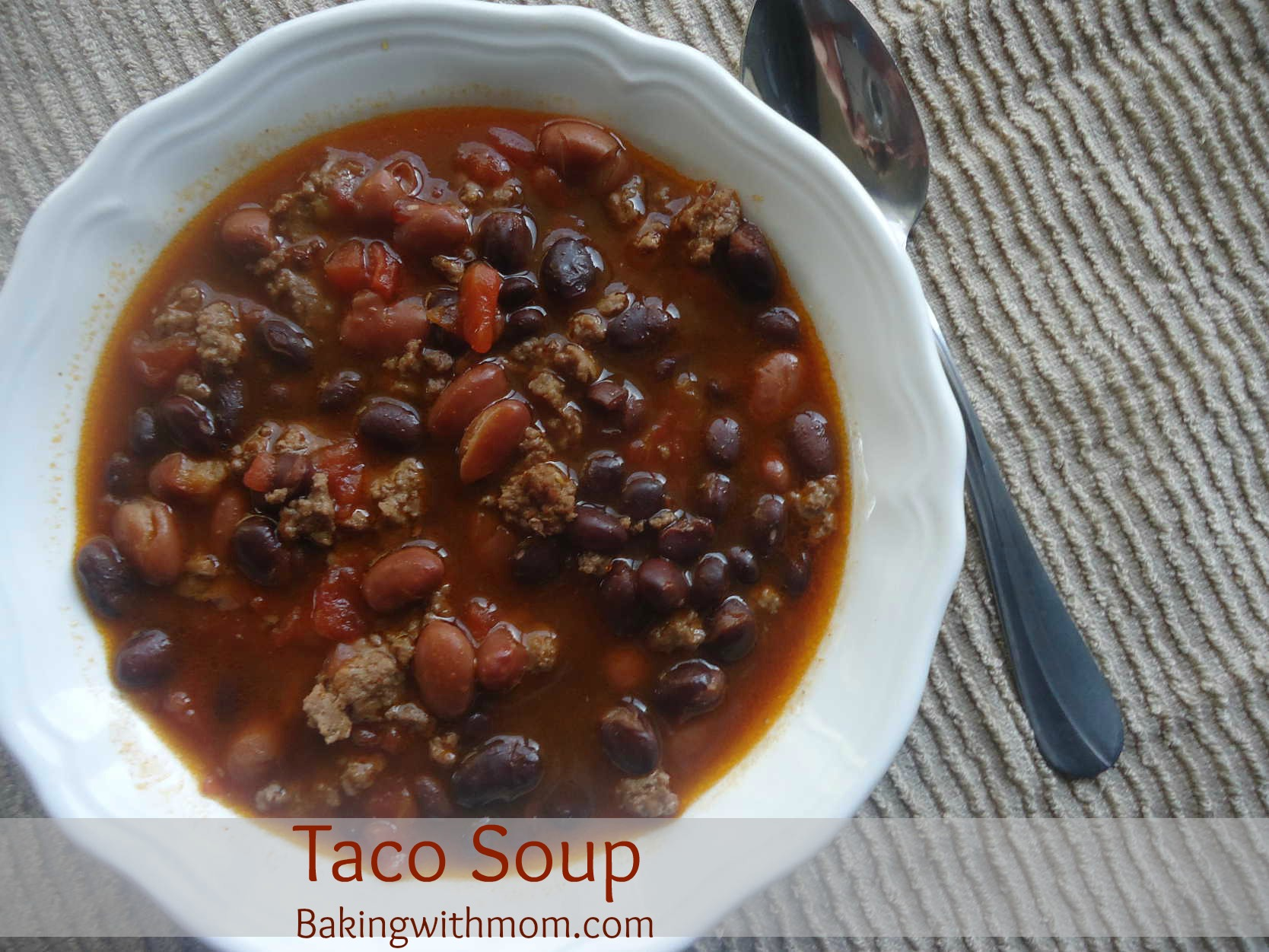 taco soup with beans, tomatoes, hamburger and cheese