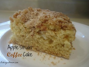 apple coffee cake with cinnamon and brown sugar on a white plate