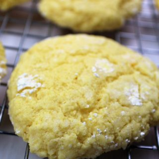 Gooey Butter Cookies on a cooling rack with powdered sugar