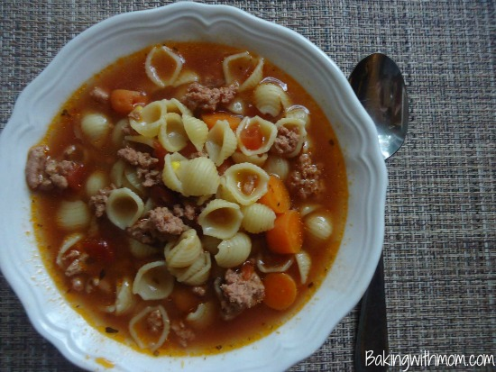 hamburger soup recipe made in the slow cooker with tomatoes, pasta, carrots