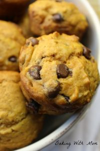 Pumpkin Chocolate Chip Muffins in cream bowl on white towel