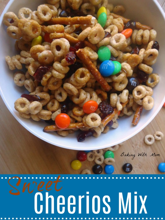 Sweet Cheerios Mix with M&M's, dried cranberries and pretzels in a white bowl