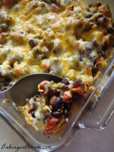 taco tortilla casserole with beans, tomatoes and spices
