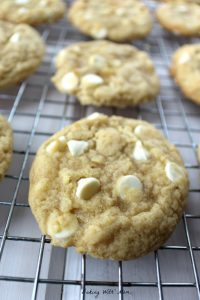 Soft and Chewy White Chocolate Chip Cookies on a cooling rack