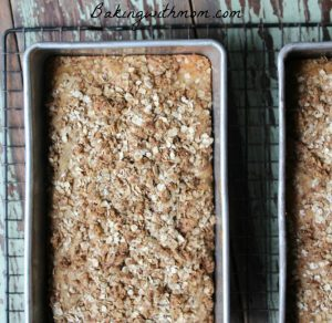 Apple Cinnamon Bread With Crumb Topping in two loaf pans on a cooling rack