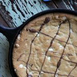 White Chocolate Chip Skillet Cookie with white chocolate chips baked in a cast iron skillet