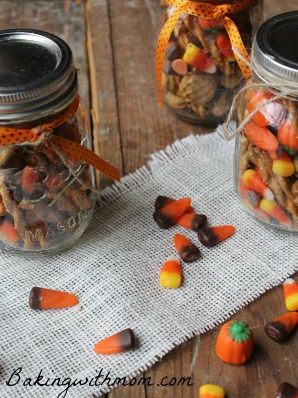 Fall snack mix with candy corn in glass jars