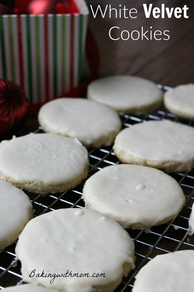 White Velvet Cookies with cream cheese and creamy white frosting on a cooling rack.