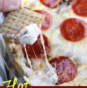 Hot Pizza Dip with pepperoni and cream cheese in a pie pan and with crackers