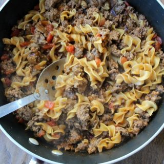 hamburger and noodles in a frying pan