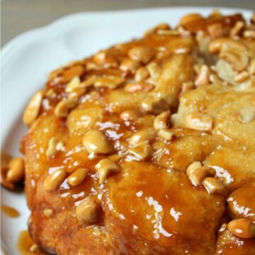 Caramel Rolls drizzled with caramel on a white plate