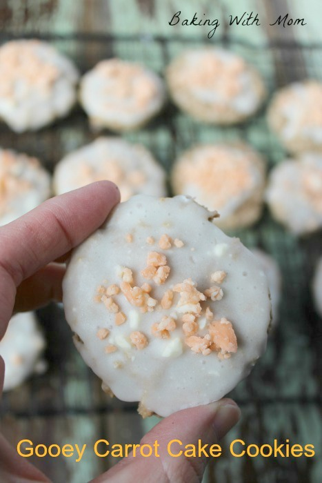 Gooey Carrot Cake Cookies with white frosting and Hershey's sprinkled on top