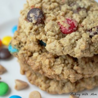 Monster Cookies with peanut butter chips, chocolate chips and M&M's on a flat white surface