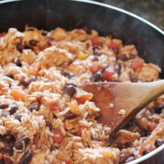rice, beans, chicken in a frying pan