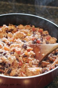 One Dish Mexican Chicken And Rice made in one pot, this meal has beans, tomatoes, chicken and rice for a healthier meal to feed your family