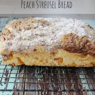 Peach Streusel Bread is loaded with sweet peaches and has a cinnamon brown sugar topping. Delicious for breakfast or as a snack