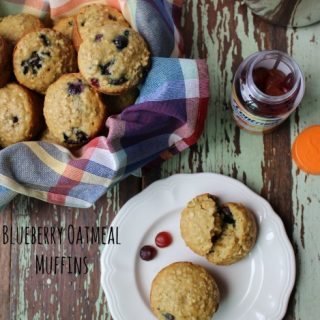 blueberry muffins on a white plate and in a basket