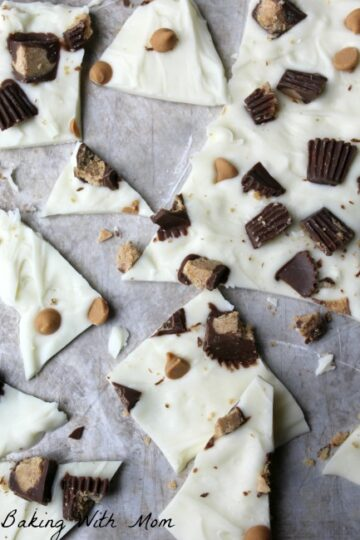 3 ingredient peanut butter cup candy bits of candy bark scattered on waxed paper