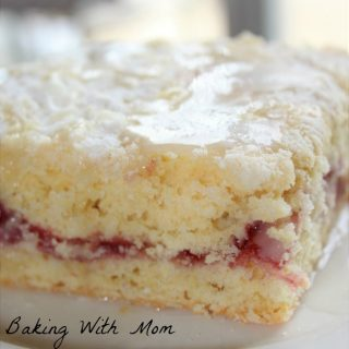 Cherry Filled Coffee Cake for breakfast or brunch. Cherries, sugar topping and a powdered sugar glaze