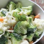 Ranch Broccoli Cauliflower Salad with veggies, cheese, ranch dip. A side dish to feed your family and take on picnics