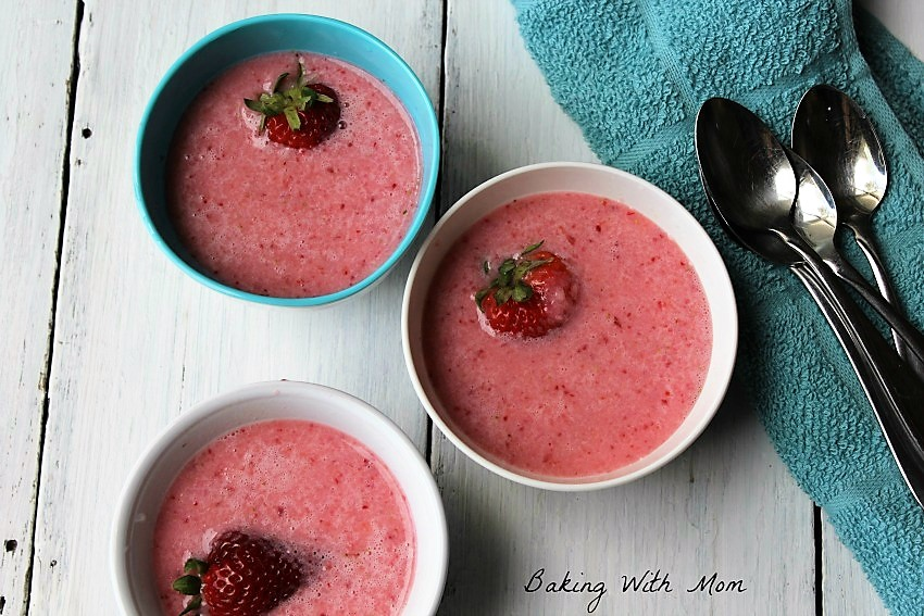 Strawberry Soup in small bowls with ginger ale, sugar and strawberries