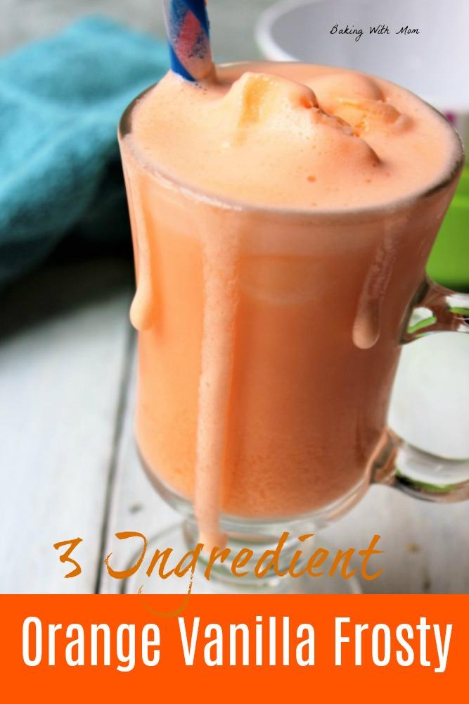Orange vanilla frosty in a clear mug with a straw
