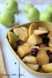 Cinnamon apples with craisins in a brown bowl