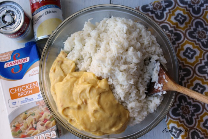 Rice and cream of chicken in bowl with mixing spoon