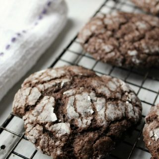 Soft And Gooey Chocolate Cookies rolled in powdered sugar