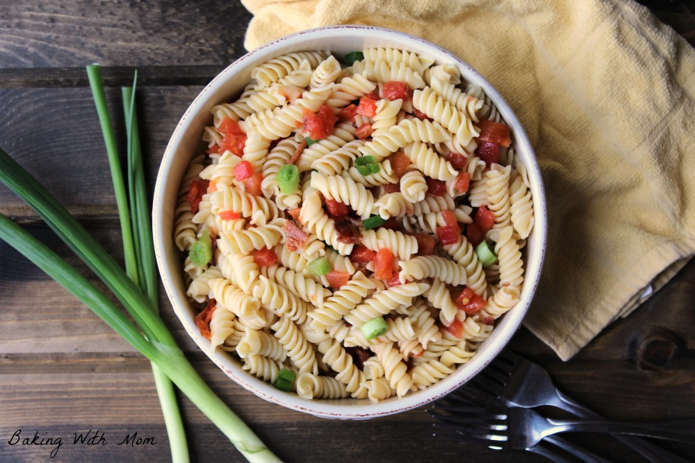 4 Ingredient Pasta Salad with tomatoes, pasta and green onions in a cream colored bowl