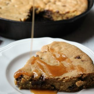Caramel Chocolate Chip Skillet Cookie with drizzled caramel on top