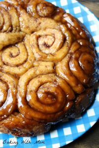 Caramel Cinnamon Rolls close up on a blue plate