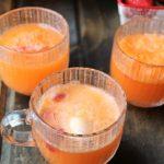 Orange soda with orange cream ice cream and strawberries in glass punch bowl
