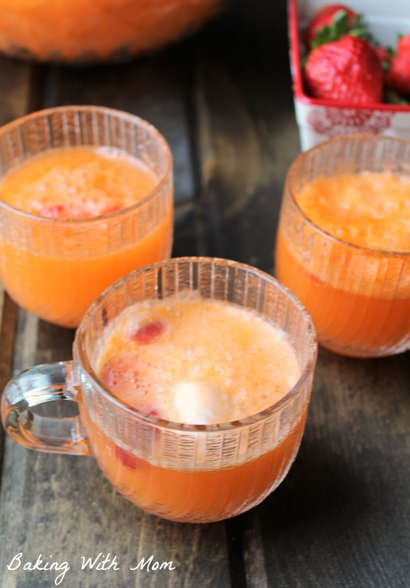 Orange soda with orange cream ice cream and strawberries in glass punch bowl