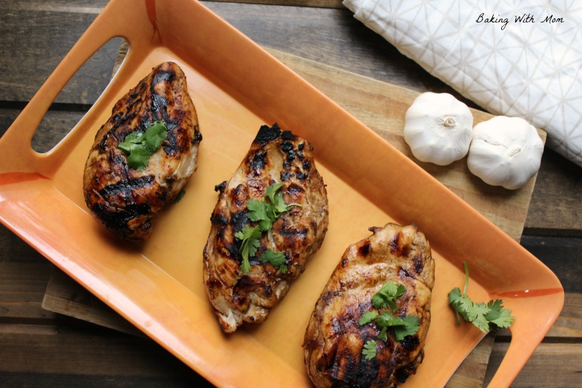 EASY Grilled Chicken Marinade chicken breasts with cloves of garlic