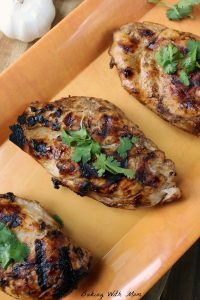 EASY Grilled Chicken Marinade Chicken breasts with basil on top