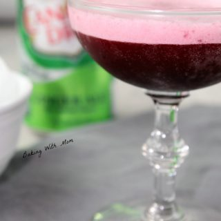 wine glass of grape black cherry fizz