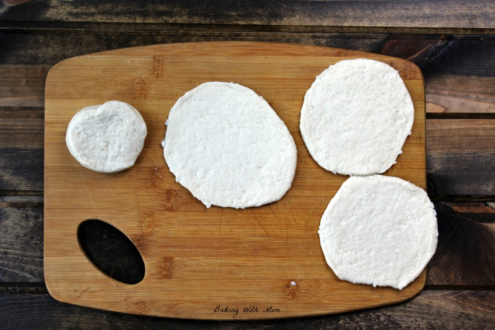 Flattened biscuits on a cutting board