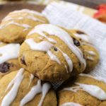 Frosted Pumpkin Chocolate Chip Cookies pumpkin chocolate chip dessert with white frosting