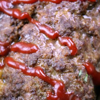 Stuffed Cheesy Meatloaf with ketchup on top