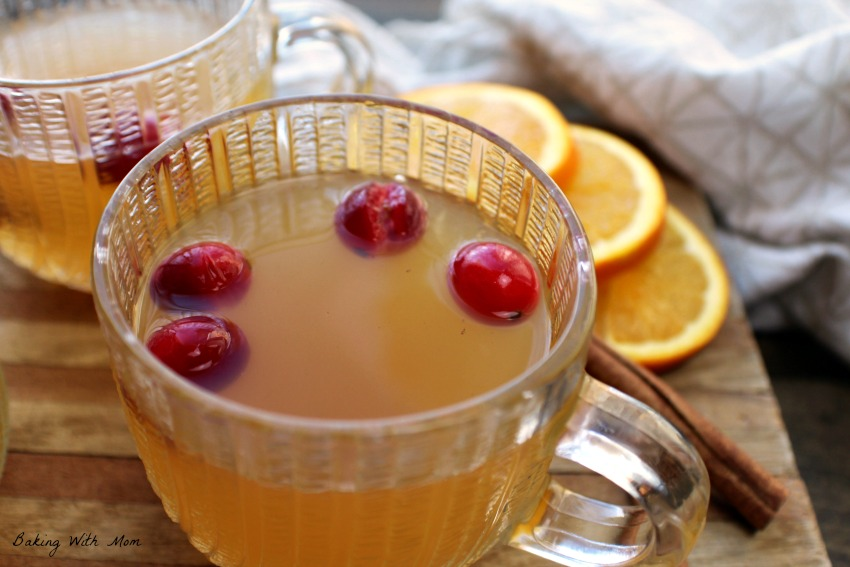 Slow Cooker Spiced Apple Cider with oranges in background