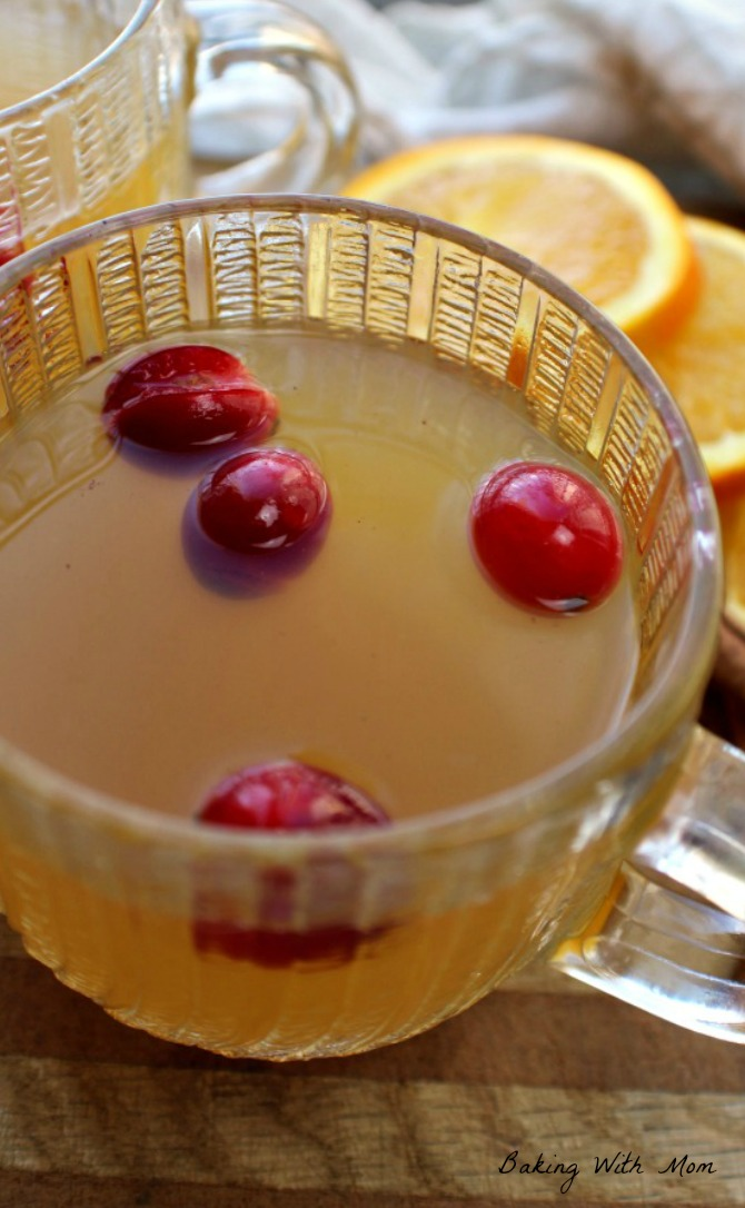 Slow Cooker Spiced Apple Cider with oranges, cranberries and cinnamon. Easy recipe great for the holidays or parties #applecider #slowcooker #bakingwithmom