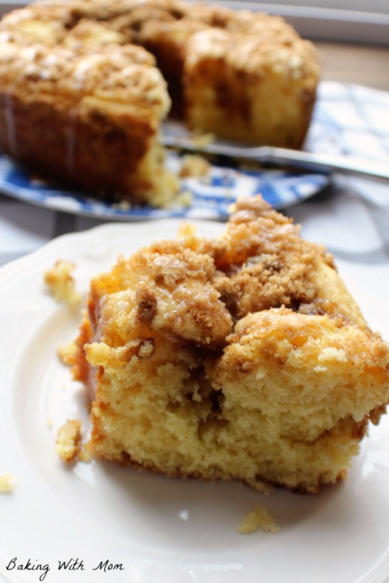 Brown Sugar Coffee Cake recipe on a white plate with a white frosting glaze