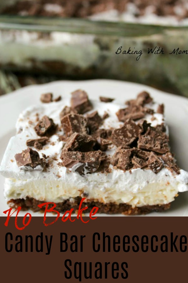 Cheesecake squares with candy bar topping on a white plate