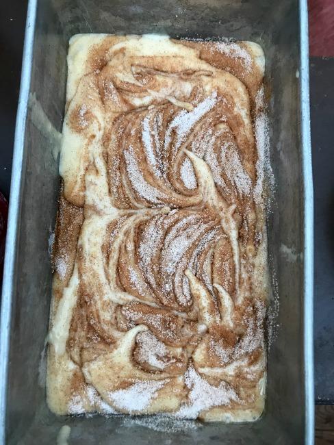 Cinnamon swirl dough in a pan