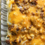 sausage and hashbrowns in a clear baking dish