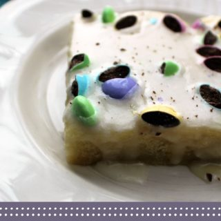 Easter Poke Cake with M&M's sprinkled on top