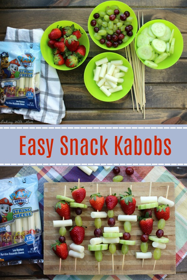Ingredients of cheese, cucumbers, strawberries and grapes. Easy Snack Kabobs with fruit and string cheese on a cutting board on bottom.