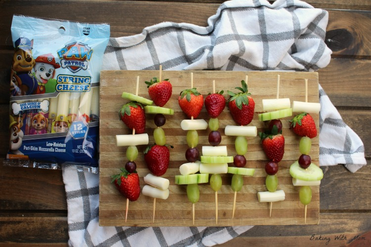Easy Snack Kabobs with fruit and cheese on a cutting board.