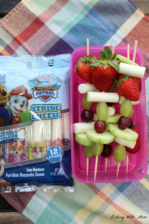 Fruit and cheese kabobs in a container